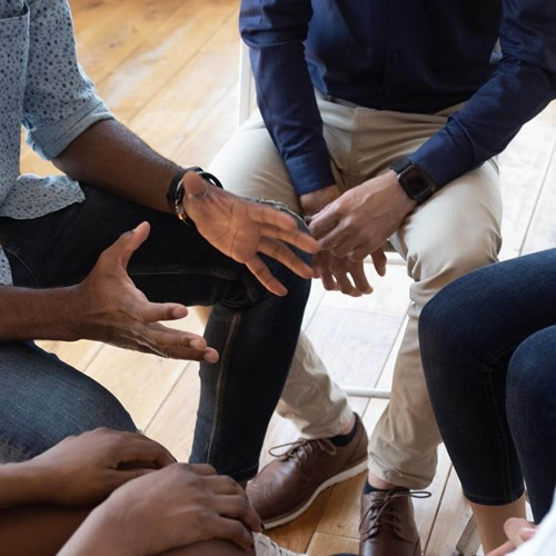 Group talking, focusing on hands